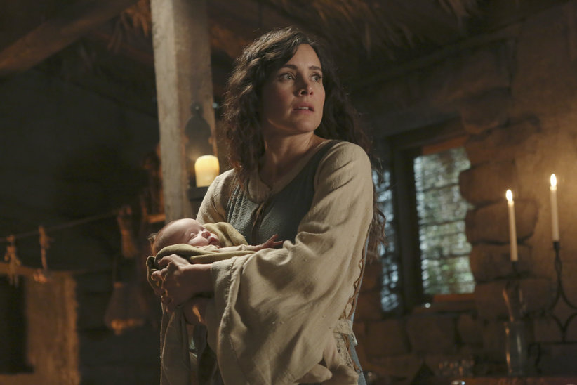 Milah and her baby son, Baelfire, look to the door to see someone coming home that she's not eager to see.